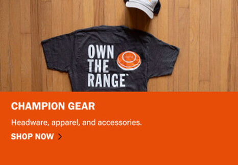 Champion Apparel on wooden background