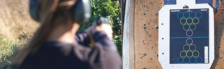 Shooter aiming at VisiColor Targets