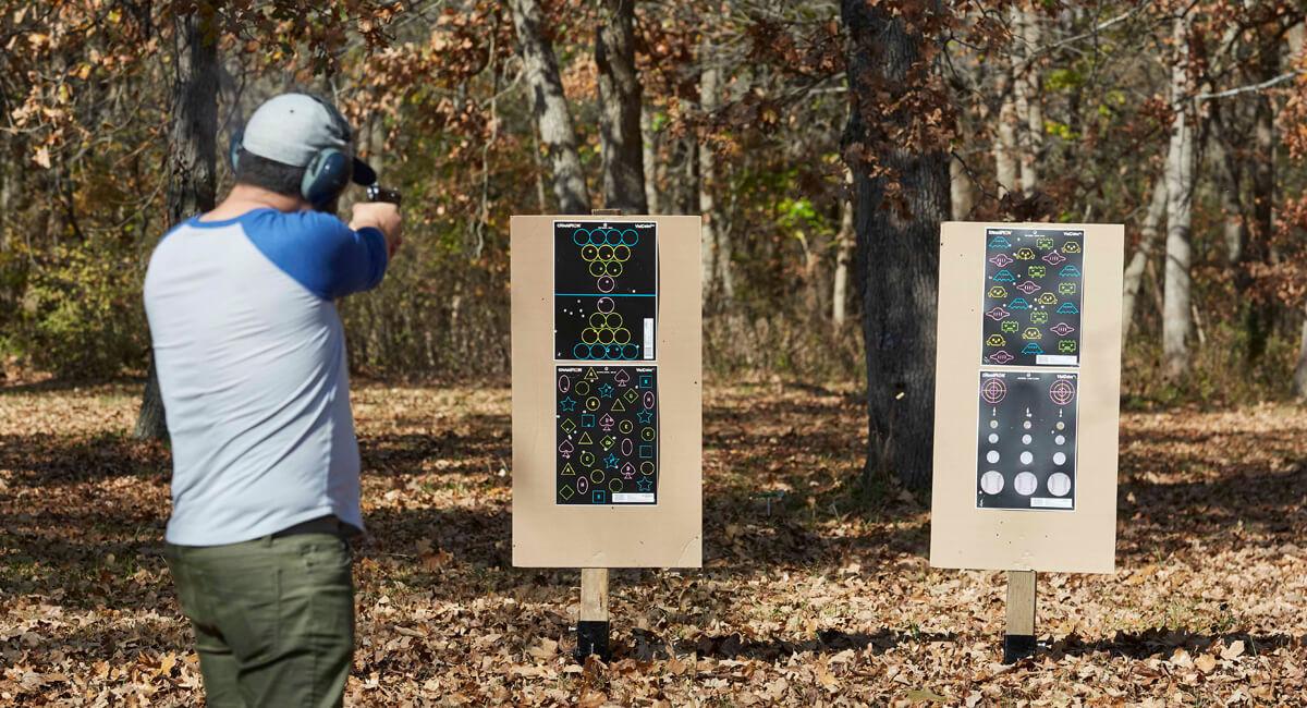 Man aiming rifle down range.